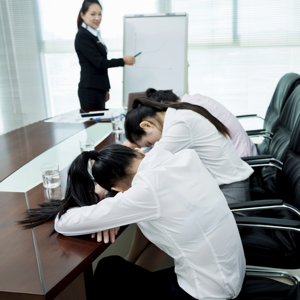 Three people asleep in a meeting