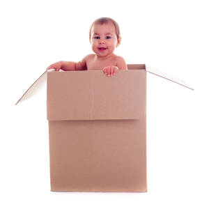 Baby standing in a cardboard box
