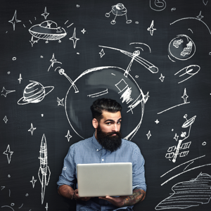 Bearded man with a laptop thinking about space