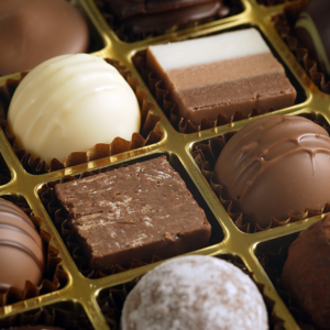 An assortment of chocolate truffles and pralines in a box