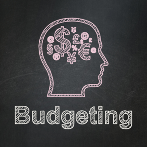 Head with finance symbols and budgeting written on a blackboard
