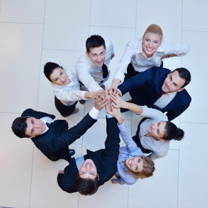 Business people joining hands as a team in a circle