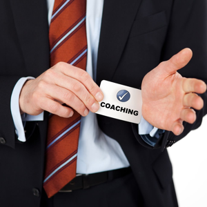 Businessman pulling a coaching card out of his sleeve