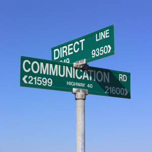 Direct communication sign against a blue sky
