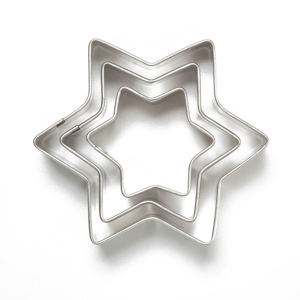 Star cookie cutters on a white background