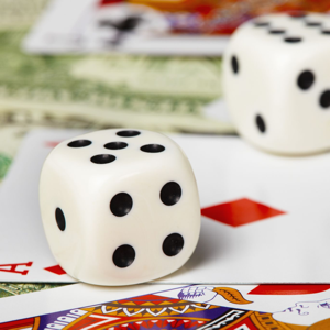 Dice, playing cards and money close-up