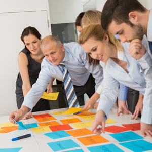 Business team brainstorming using coloured labels on an office table