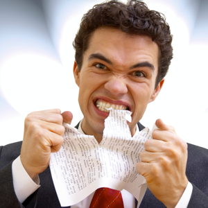 Furious businessman tearing up a document