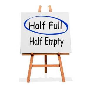 An sign with half full and half empty written on it