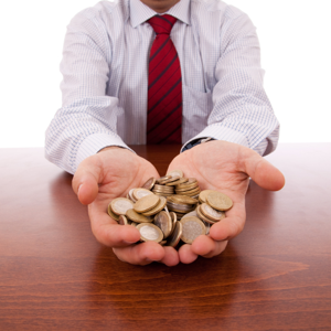 Businessman showing a lot of coins in his hands
