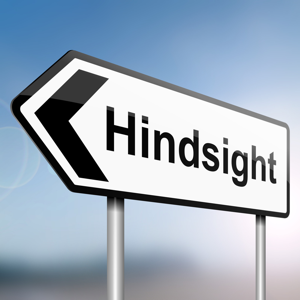 Sign post with directional arrow containing the word: Hindsight
