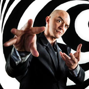 A hypnotist gesturing inducing a trance on a black and white swirl painted background