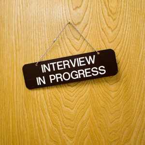 Door sign stating: Interview in Progress