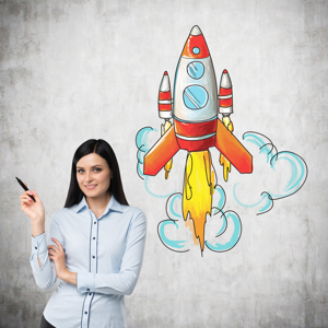 A woman with pen in hand standing next to an image of a rocket