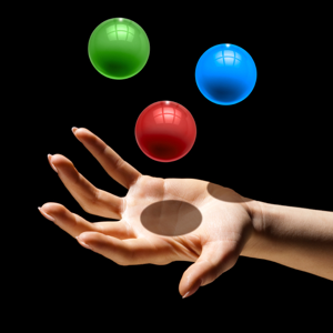 Hand juggling three coloured balls