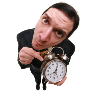 Man pointing at an alarm clock