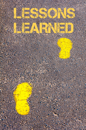 Yellow footsteps on a path walking towards the words lessons learned