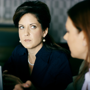 Woman looking annoyed in a meeting