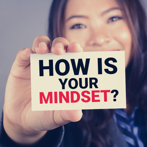 How is your mindset? Message on a card shown by a woman