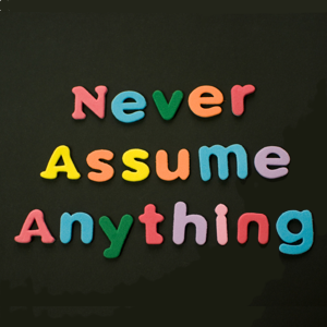 Coloured letters spelling out: Never Assume Anything