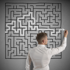 Businessman finding the solution to a maze