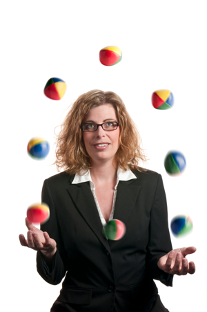 A businesswoman juggling many balls all at once