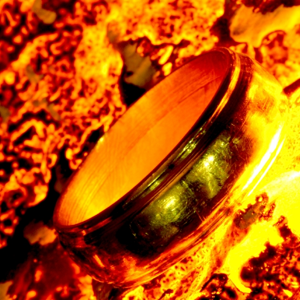 A plain band ring in a pool of fire and lava