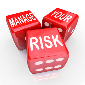 Three red dice reading: Manage your risk