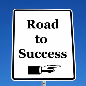 Sign reading road to success