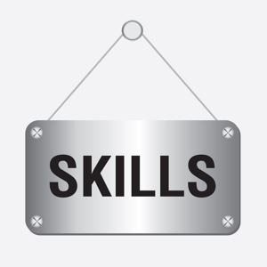 Silver metallic skills sign hanging on a wall
