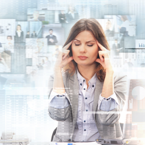 Stressed business woman in front of business themed collage