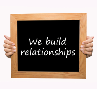Board reading: We Build Relationships