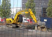 Large yellow digger on a construction site