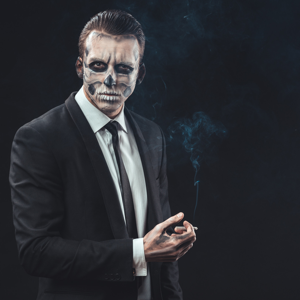 Businessman smoking with make-up skeleton